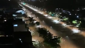 Torrential rains turned city streets into rapid rivers