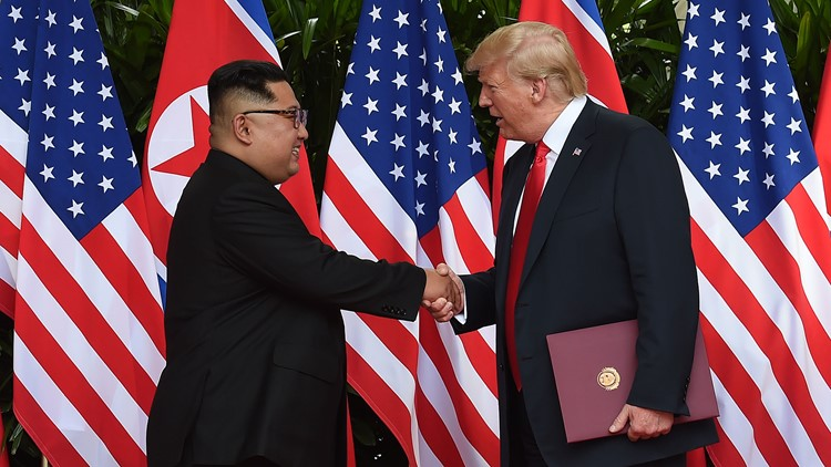 Trump and Kim Jong Un shake hands
