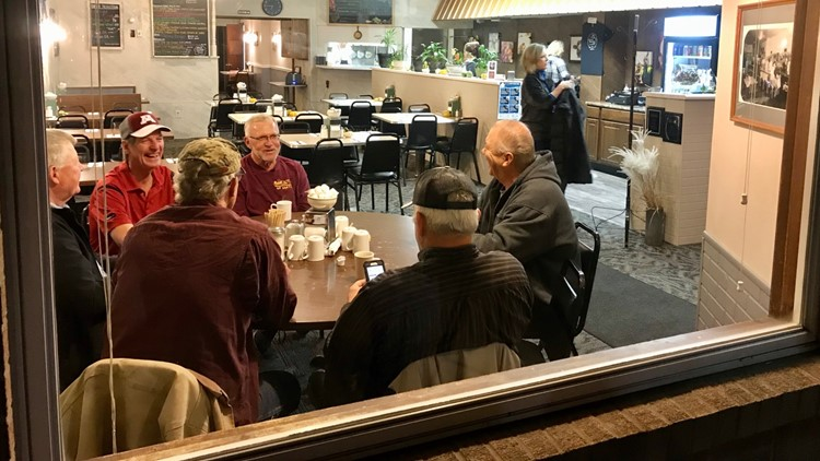 Farmers and retirees occupy the window seat before sunrise at the Cup N' Saucer