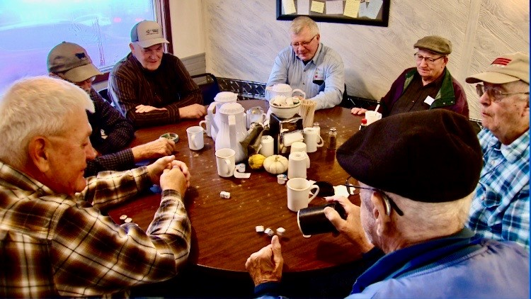 The mid-morning dice group meets at the Cup N' Saucer