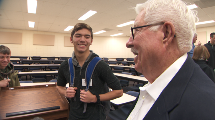 Cal O'Brien, a Hastings High School student, shares a moment with 88-year-old Air Force veteran Loren Mollet