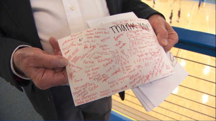Air Force veteran Loren Mallot holds the thank you card signed by 9th graders at Hastings High School.
