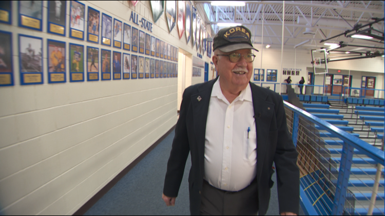 88-year-old Loren Mollet walking the elevated track at Hastings High School.