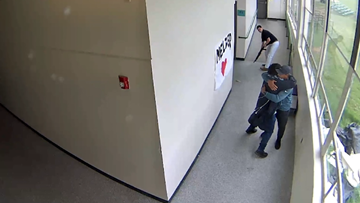 Powerful video shows teacher hugging student moments after disarming him