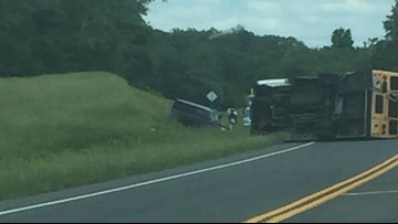 22 hurt after NC school bus struck by truck, flips on its side