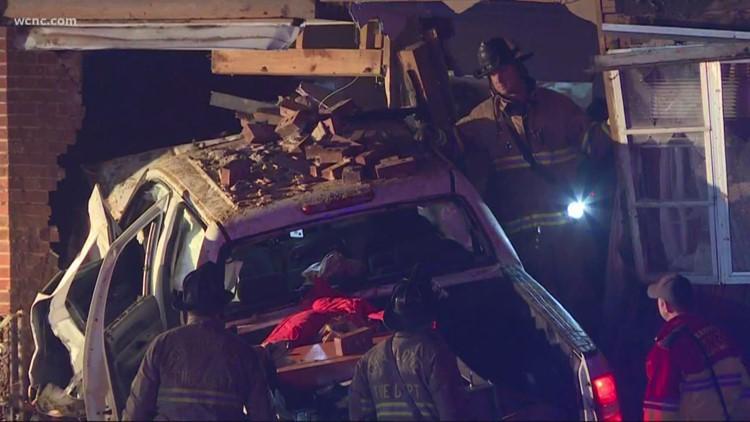 Truck slams into Charlotte home