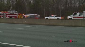 Semi crashes off I-40/85 when car loses control