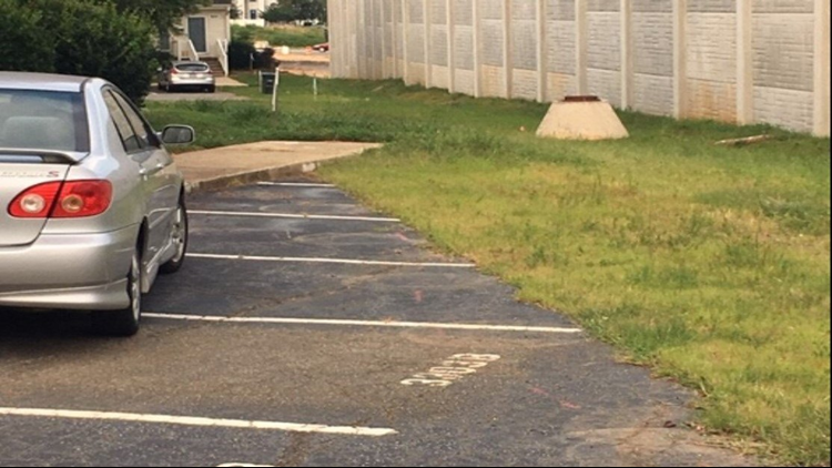 Urban Loop Noise Wall Replaces Townhome Parking Lot Creating A Big Problem For Greensboro Neighborhood