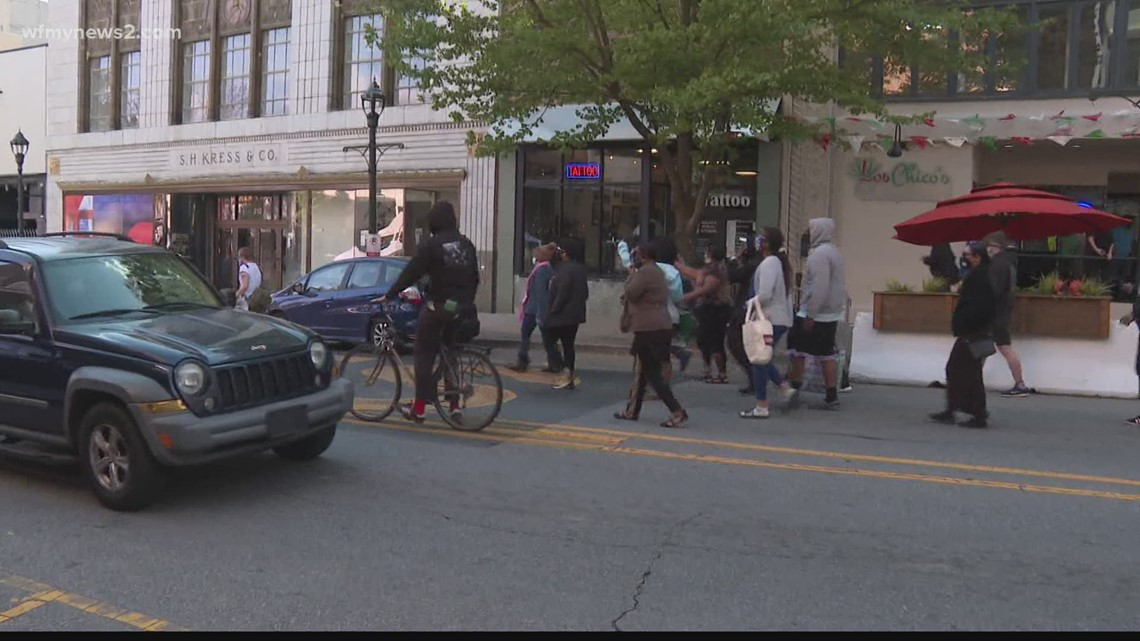 People march through Downtown Greensboro after guilty verdict in Derek Chauvin case