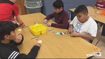 Kids at Balfour Elementary make origami heart messages for William Sidebottom