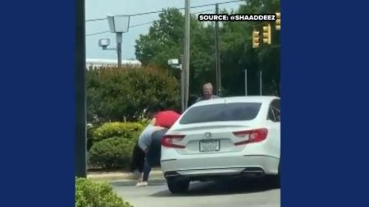 2 charged after gas station line fight amid panic-buying