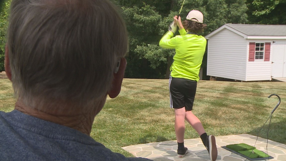 Young boy hits golf balls 200 yards, ending up in neighbor's yard