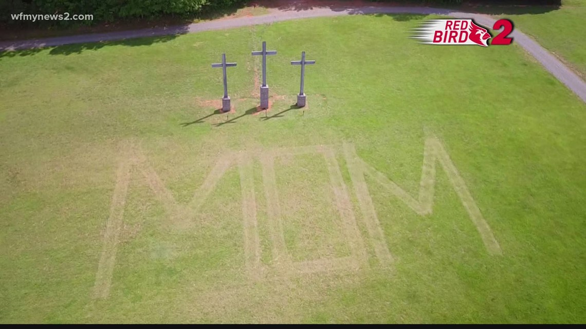 Cemetery lawn mower cuts grass to spell out 'Mom' for Mother's Day