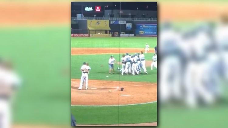 Watch this pitcher rush to the plate to console his childhood friend before celebrating with his teammates.