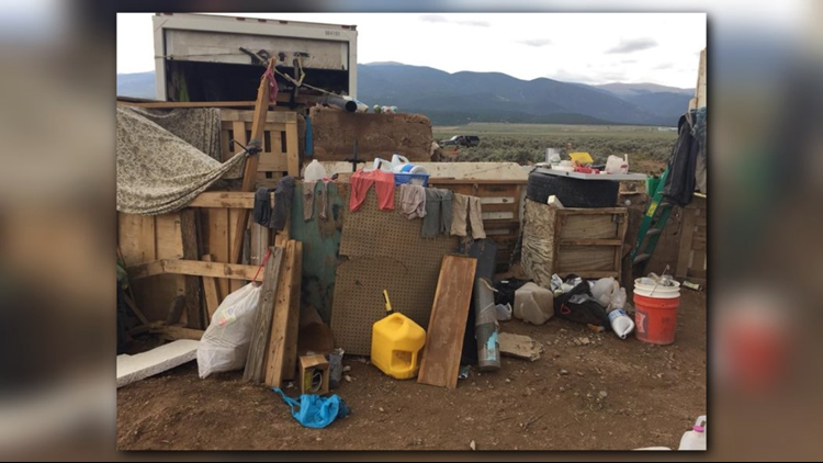 There was little food in the compound, which consisted of a small travel trailer buried in the ground and covered by plastic with no water, plumbing and electricity.
