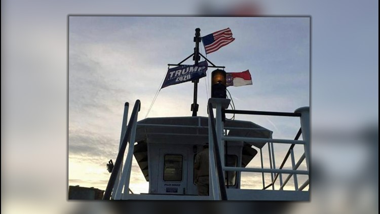 """A passenger on the MV Frisco ferry took a picture of the """"Trump 2020"""" flag flying below the U.S. flag and even with the North Carolina flag last month and posted it to social media."""