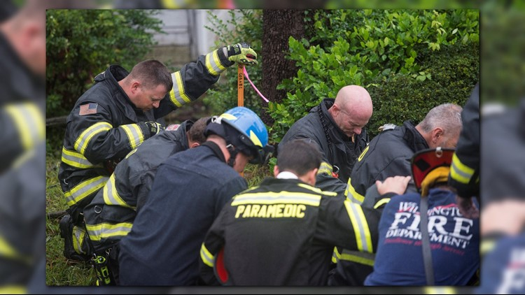 firefighters pray_1536957952805.png.jpg