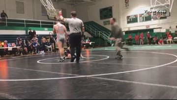 Dad charged with assault after tackling student who was wrestling his son