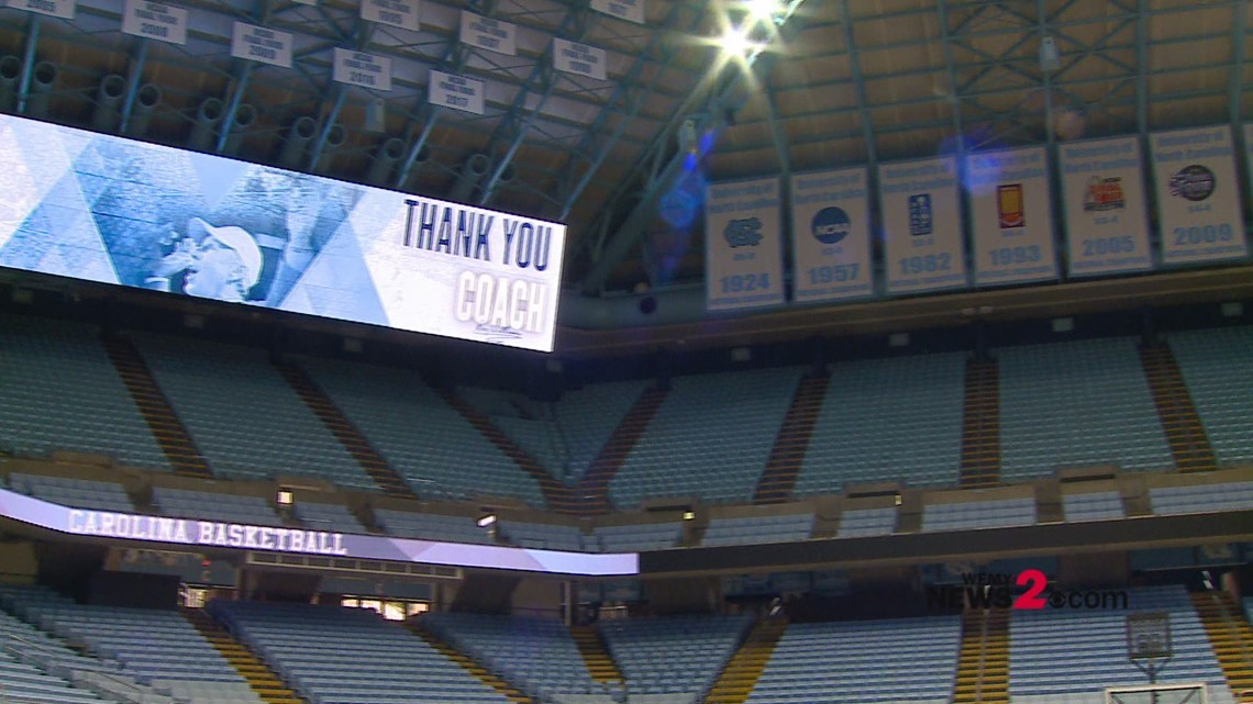 UNC's NCAA Championship banners inside the Dean Dome featuring wins under coach Roy Williams