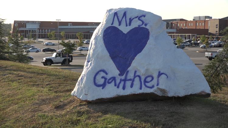 On Friday, students painted a rock memorial for Mrs. Gaither in front of Davie County High School