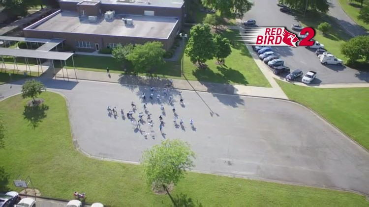 Drone Video: Mendenhall Middle School band performs in parking lot