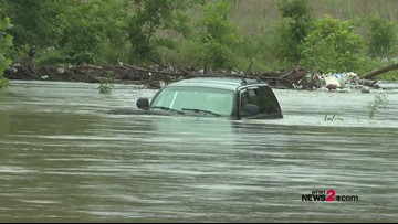 Woman Rescued From Car After Getting Trapped, When Driving on Flooded Road in Guilford County