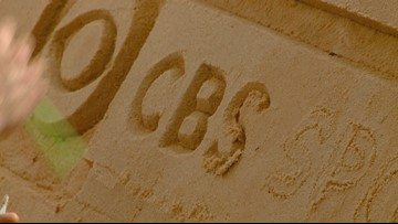 Crews Carving CBS Sports Into The Giant Sand Castle At The Wyndham Championship