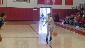 NCHSAA 4th round Basketball playoff games featuring Triad High Schools