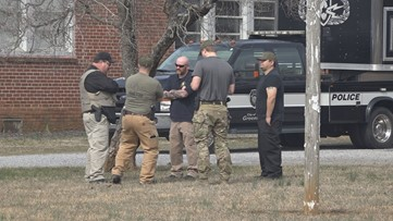 Man barricaded in home believed to be connected to bomb threats at Rockingham County schools