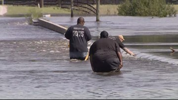 Couple rescued from fast moving floodwaters in Cumberland County