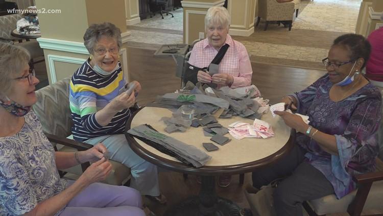 Greensboro senior living residents helping homeless