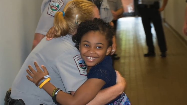 Rosalyn gives out hugs at the Chatham County Sheriff's Office.