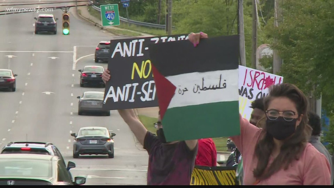 Dozens of people gather on Wendover Avenue to protest violence in the Gaza Strip