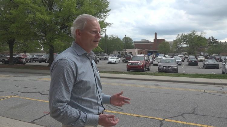 Roy Carroll standing in front of the parking lot his company owns, the site of cancelled plans.