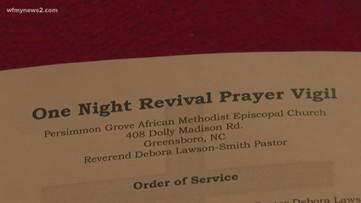 Greensboro church community holds vigil for church hit by vandals