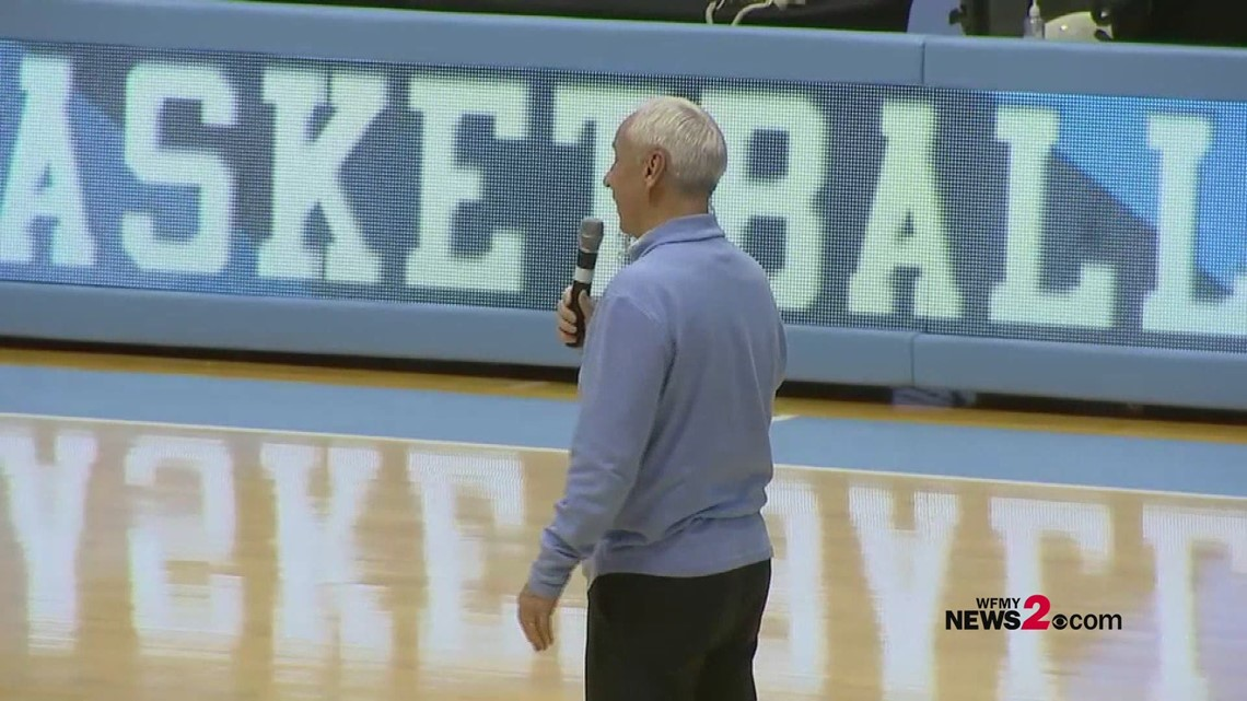 UNC's Roy Williams kissing the Dean Dome floor after the Tar Heels final home game vs. Duke