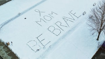 Person leaves Valentine's Day message for mom in snow outside
