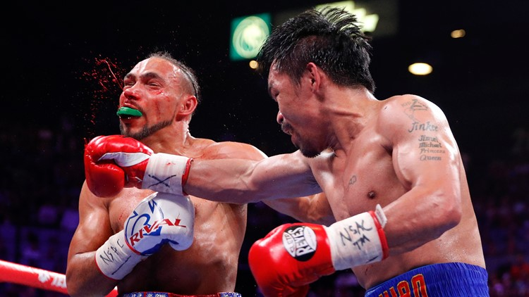 APTOPIX Pacquiao Thurman Boxing