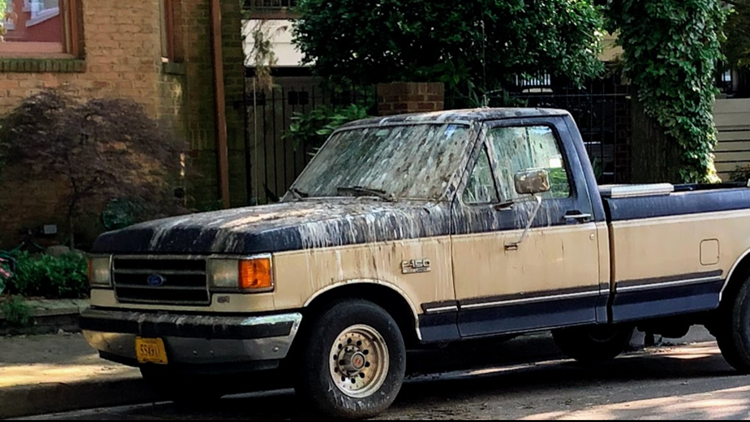 A parked truck on College Place is covered in bird poop.