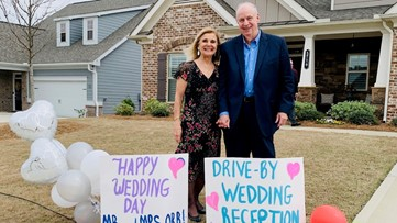 Couple in quarantine ties knot in drive-by ceremony
