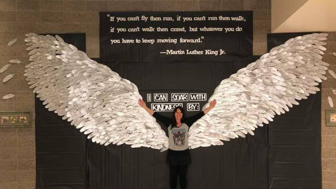 Elementary school students make wings out of 700 feathers to honor MLK